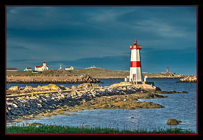 Lighthouse and harbor, St. Pierre et Miquelon.
