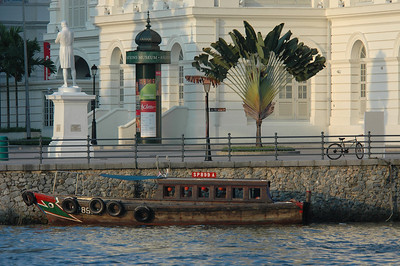 Boat on canal outside Asian Civilizations Museum, Singapore.