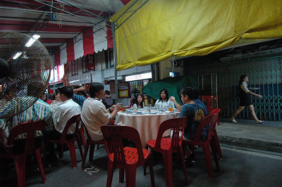 Outdoor restaurant at night, Dunlop Street, Singapore.