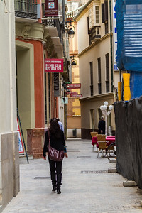 Woman walking on street - Spain