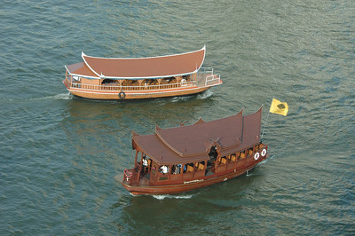 Boats on Chao Praya river, Bangkok, Thailand.