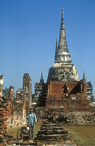 Man cuts the lawn, Ayutthaya, Thailand, ancient capital of Siam.