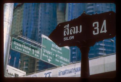 Road sign, central Bangkok, Thailand.