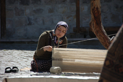 Carpet weaving in the courtyard outside this shop in Cappadocia, Turkey.