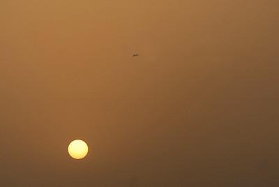 Airplane at twilight, Dubai, United Arab Emirates.