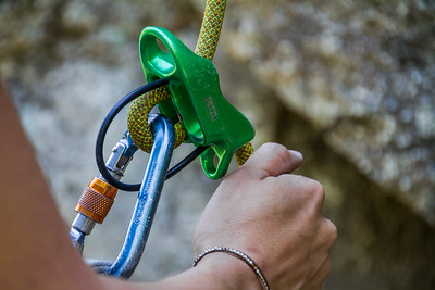 "Close-up of woman""s hand adjusting climbing harness - USA - Colorado"