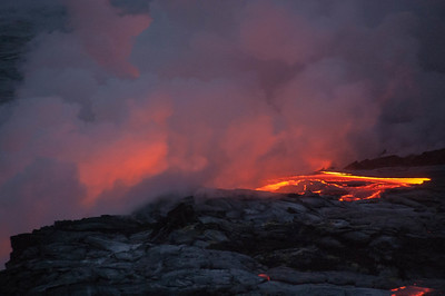 Lava flowing into the Ocean south of the big island of Hawai. Early morning before sunrise.