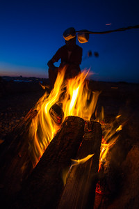 Man sitting near campfire - USA - Washington - Bellingham