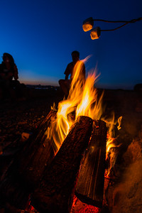 Couple sitting near campfire - USA - Washington - Bellingham