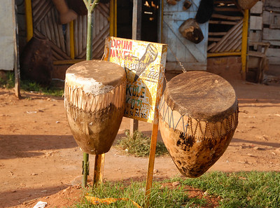 Drum maker's shop ouside Kampala, Uganda.