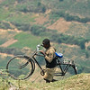 Transporting his transportation near Nteko village, Uganda.
