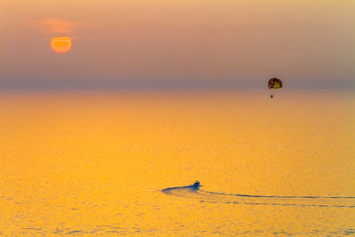 Tourist parasailing at sunset - UAE - United Arab Emirates - Dubai