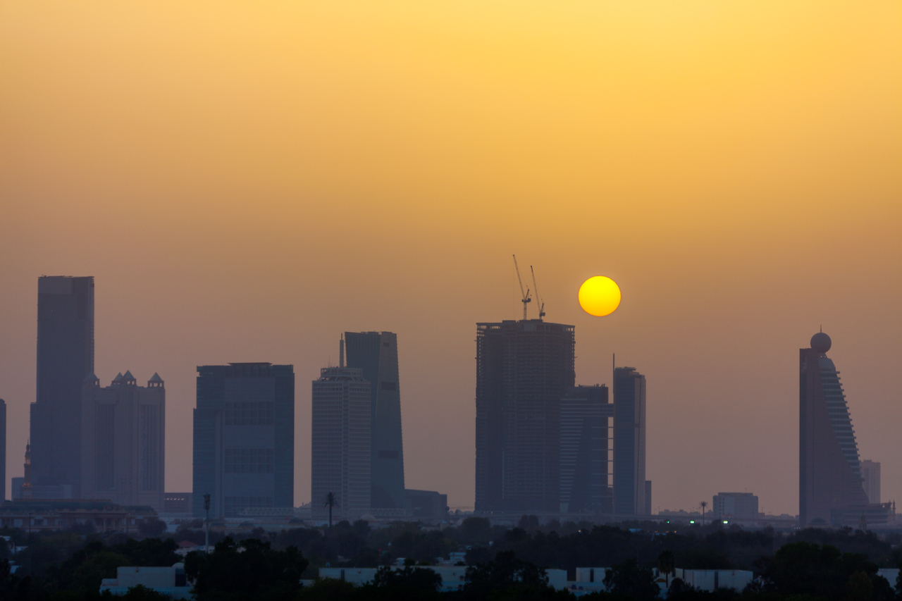 Dubai skyline as seen in silhouette at sunset