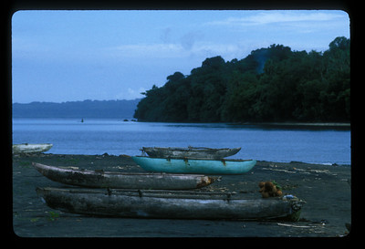 Canoes on the beach, Espiritu Santo Island, Vanuatu.