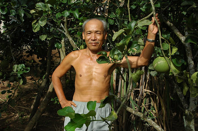 A man and his fruit, Mekong delta, Vietnam.