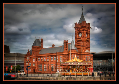 The old passenger ship terminal and a carousel, Cardiff, Wales.