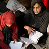 Around 30 girl studies inside one of NRC's ALP class in Rodad District, Nangarhar. The children were displaced mostly from Kapisa Provinve into Nangarhar and were deprived from getting education and attending school. NRC established community based school in Rodad and now, they are in fifth grade trying to catch up the regular classes after finishing sixth grade with us.<br /> <br /> Humaria, 13, is the only female in her house that got the chance to study. Her older sisters weren't as lucky as she is. They either got married or scrubbing floors and washing clothes at home. Humaria is grateful for the education she receives and hope to continue her studies and become a teacher one day. <br /> Photo: NRC/Enayatullah Azad