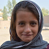 "Kabuli, 11, got her name from the city she was born in, Kabul. She used to go to school, but since the other kids started abusing her and taking her books, she stopped going. <br /> <br /> ""We have no one to stand behind us and support us, so that's why I couldn't send her back,"" said her mother. <br /> <br /> Photo: Enayatullah Azad/NRC."
