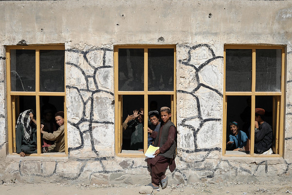 "This is Charamgar secondary school some 5 kilometers on the northern side of Trinkot, Uruzgan Province. This school was occupied and used as a checkpoint by an armed group for almost six months in 2015/2016. When the conflict lines changed and school resumed again, all the roofing, boundary walls and gates were either destroyed or stolen. <br /> <br /> NRC has been repairing this and some three other schools in and around Trin Kot. The work includes; Iron sheets for the roofing of schools, installing emergency gates, main gates, building boundaries walls, grill work, windows repairing, glasses and blast films for the windows. NRC also established a schools-based Protection Committee (SBPCs) for each school with support and participation of PED, Community shura.<br /> <br /> The school activities are closely monitored and checked by the community people, PED and the community has also been accountable to protect the schools from future expected incidents and they are also encouraging the families to get their children to school.<br /> <br /> Repairing work and studies continues in this school and currently around 15 staff are teaching some 600 students in two different shifts.<br /> <br /> ""We feel more safe and secure now after building the boundary walls and installing the gates. Now, we have bigger yard and students can play inside the school building. The boundary is also keeping the school safe from any attack and flying bullets,"" said Nida Mohammad, the Chramgar school principle.<br /> Photo: NRC/Enayatullah Azad"