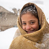 """""""It was very cold inside and I thought if I go outside and walk I might feel warmer,"""" says Roqia, 11, standing outside her makeshift home in a snowy day in KABUL. <br /> <br /> Rogia doesn't have enough clothes and proper slippers to keep her warm in a cold. Her family do not have sufficient firewood to keep the oven burning all the time and they only burn it once in a day and if the weather is freezing cold, they might burn it twice in a day. They burn plastics, cartons, packets and other waste materials they have collected during the summer season. <br /> """"The house we have is out of plastic bags, blankets and mud. As soon as the oven dies the home gets cold,"""" she says. """"It's very cold during the night and we wakeup many times due to cold. Sometimes, I feel pain and burn in my feet, legs and back due to the cold."""" <br /> <br /> Kabul gets very cold during the winter and last night only, the temperature dropped to -16 Celsius. Photo: Enayatullah Azad/ NRC"""