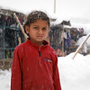 Salma, 9, years old standing in front of her makeshifts in an IDP settlement in Kabul. The first winter snow is falling and she doesn't have proper wearing to brave the cold. <br /> <br /> Salama and many other children in this settlement do not go to school and instead, they go to streets to collect scraps and cartons to burn during the winter. <br /> <br /> Salma and family has an oven at home burning plastics and other waste materials they can find on the streets. Though this is a third winter that Salma survives in this settlement, but she had gone through a lot of difficulties so far. photo: Enayatullah Azad / NRC