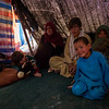 Zarafshan's family inside their makeshift shelter in Sinjitak IDP site.
