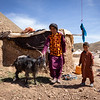 Abdullah with his only goat and freshly built mudhouse in Sinjitak IDP site