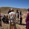NRC camp management staff talk to newly drought displaced people in Sinjitak IDP site in Badghis. Families have recently been displaced from their homes across Badghis province due to crops failure and not having access to water. There are more families to come as water sources drying up and crops fail to grow. <br /> <br /> Photo: Enayatullah Azad / NRC