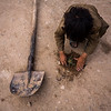 A boy plants a branch in dry earth outside their small mud home in the Police Rah settlement for IDPs, Herat, Afghanistan.<br /> <br /> Herat, May 2017<br /> <br /> Photo NRC/Jim Huylebroek