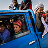 Boys no older than 13 from Helmand manoeuvre a pickup filled with refugees from Zaranj towards the lawless borderlands between Afghanistan, Pakistan and Iran.<br /> <br /> Nimruz, September 2015<br /> <br /> NRC/Jim Huylebroek