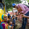 Hasina waits to board the bus to her new home in the refugee camp