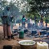 Displaced women preparing food in the schoolyard