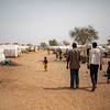 A man and an aid worker walking in Barsalogho displacement camp