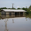 The water marks on the side of the building show that the water is slowly receding but this is little comfort to the 10,000 people whose homes have been destroyed.<br /> <br /> Photo: Chanel Igara/NRC