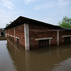Another house is half-way submerged in the Cité Kolongo neighborhood of Bangui, Central African Republic.<br /> <br /> Photo: Itunu Kuku/NRC
