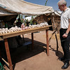 Jan Egeland is taking a quick look at a stall in the Lazare camp in Kaga Bandoro. Nearly 7700 displaced persons live on the site. Credit: Hajer Naili/ NRC