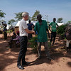 Jan Egeland is greeting a displaced man at the Lazare camp in Kaga Bandoro. Nearly 7700 displaced persons live on the site. Credit: Hajer Naili/ NRC