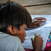 Boy studying in the improvised shelter