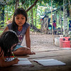 Girls studying in the improvised shelter