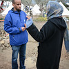 Protection officer Abdifatah Ahmedy is seconded from NRC´s emergency roster NORCAP to support UNHCR at Lesvos. He is working at Moria registration centre. Here he is speaking with an Afghan woman outside the registration centre. Photo: Tiril Skarstein, NRC
