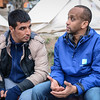 Protection officer Abdifatah Ahmedy is seconded from NRC´s emergency roster NORCAP to support UNHCR at Lesvos. He is working at Moria registration centre. Here he is speaking with a group of Iranians outside the registration centre. Photo: Tiril Skarstein, NRC