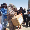 Flood Response in Sistan and Baluchestan - Woman Receives Aid Pack