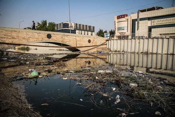 Basra canal littered with trash, plastic and debris