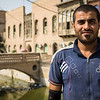 Habib stands in front of one of the old city's polluted canals - Basra