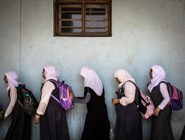 Girls from Faihaa school queuing to go to the latrines - Basra old city