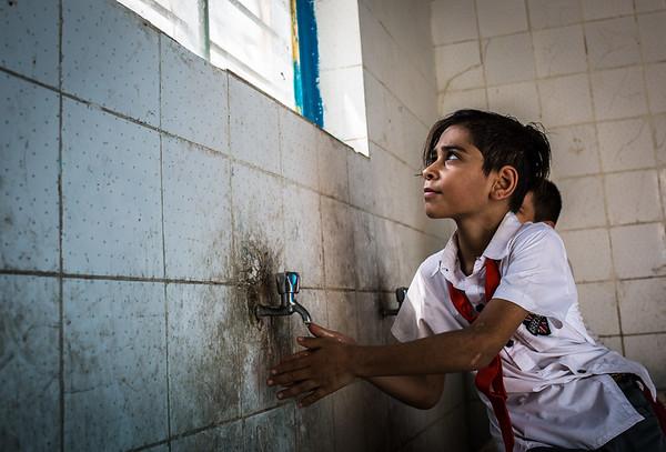 Basel washing his hands in Faihaa school - Basra old city