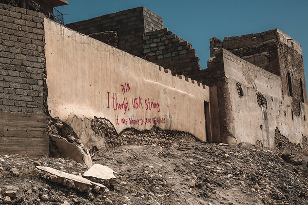 "An inscription left by Yazidis on a wall in Sinjar: "" 3/8 I thought USA strong, it was shame to leave us alone"""