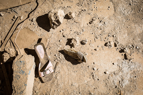 Women and girl shoes left behind in the ruins of Sinjar