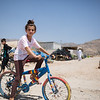 A Yazidi girl cycling in a displacement camp near Dohuk