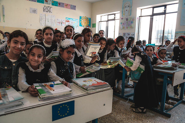 These kids were excited to show off the books they just received from the school. They are in the first grade just starting the school in Maimoona school in Mosul. About 500 students are in this school with only six teachers. In most of the classes 4 students were setting in one desk. NRC is providing incentive teachers to fill the gap.